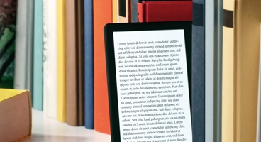This image shows books and a tablet. 