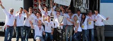 Winning team in the prototype category celebrating in front of hydrogen track